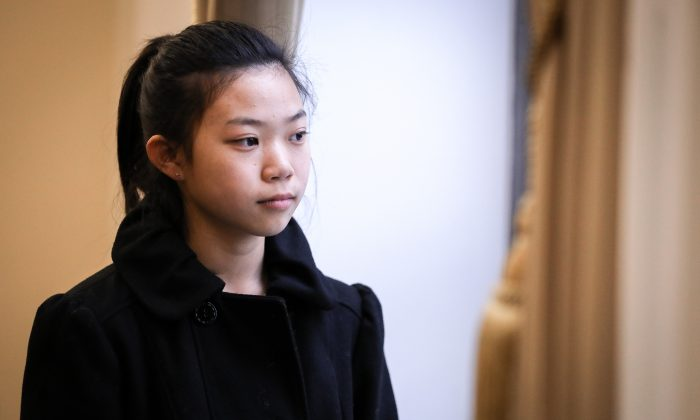 Xinyang Xu, a 17 year old girl whose father died as a result of the torture he endured in China because of his belief in Falun Gong, poses after speaking at the Deteriorating Human Rights and Tuidang Movement in China forum, at Congress in Washington on Dec. 4, 2018. (Samira Bouaou/The Epoch Times)