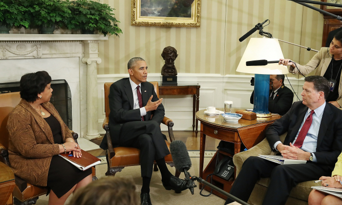 President Barack Obama (C) speaks to the media after meeting with Attorney General Loretta Lynch (L) and FBI Director James Comey in the Oval Office at the White House July 19, 2016 in Washington, DC. (Mark Wilson/Getty Images)