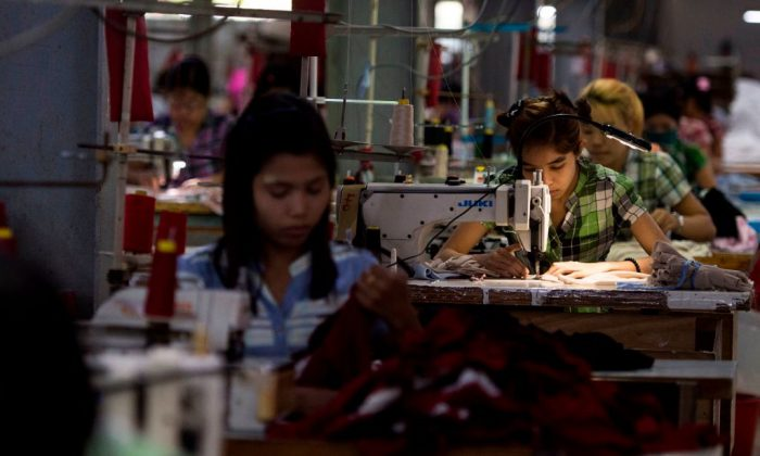 Laborers work at a garment factory in Yangon, Burma on Nov. 1, 2018. (Ye Aung Thu/AFP/Getty Images)