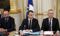 Macron Vows Tax Relief, Urges Calm in Bid to Quell Protests
