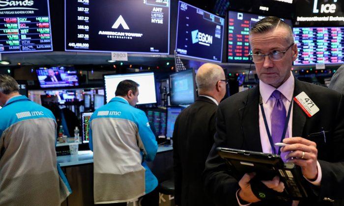 Traders work on the floor of the New York Stock Exchange (NYSE) in New York, on Dec. 7, 2018. (Brendan McDermid/Reuters)