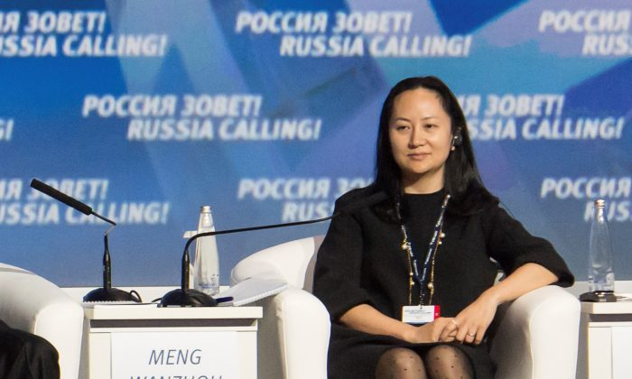 """Meng Wanzhou, Executive Board Director of the Chinese technology giant Huawei, attends a session of the VTB Capital Investment Forum """"Russia Calling!"""" in Moscow, Russia, on Oct. 2, 2014. (Alexander Bibik/Reuters)"""