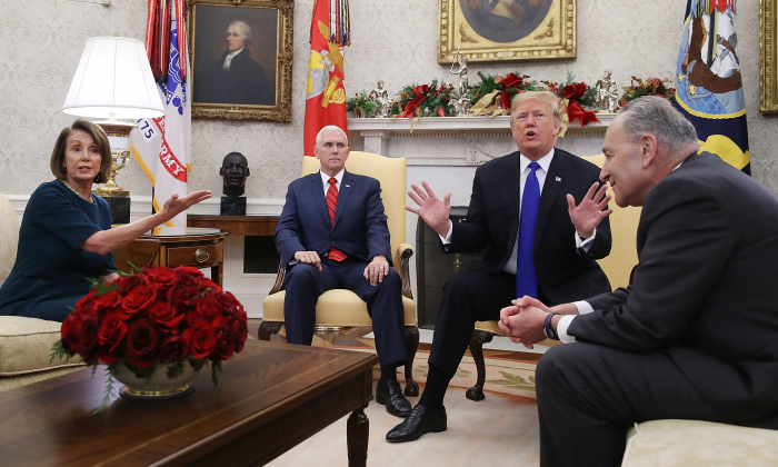 Vice President Mike Pence (second from left) listens while presumptive Speaker, House Minority Leader Nancy Pelosi (D-CA) (L), President Donald Trump, and Senate Minority Leader Charles Schumer (D-NY) argue before a meeting at the White House in Washington on Dec. 11, 2018. (Brendan Smialowski/AFP/Getty Images)