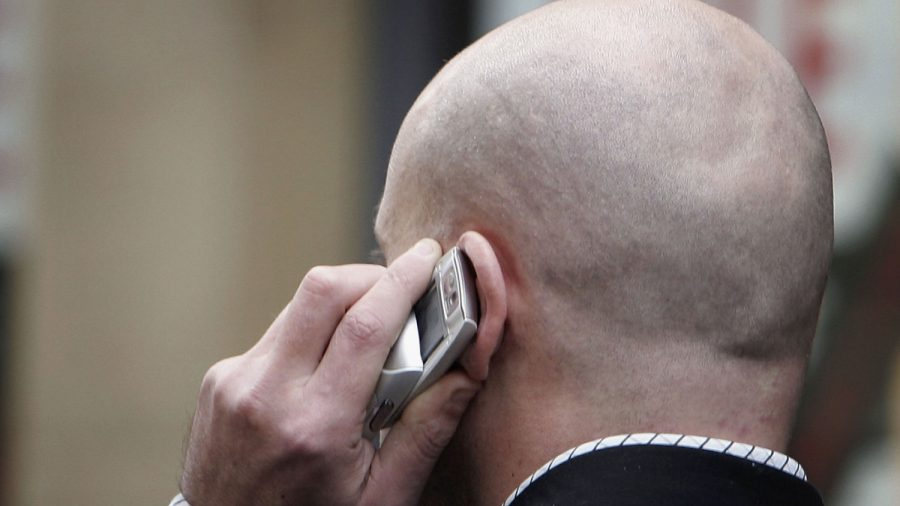 man holding phone to ear