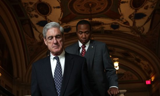 Special counsel Robert Mueller (L) arrives at the U.S. Capitol for closed meeting with members of the Senate Judiciary Committee in Washington on June 21, 2017. (Alex Wong/Getty Images)
