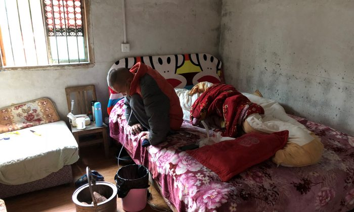 Wang Zhaohong, who suffers from silicosis, is seen on his bed in Sangzhi County, Hunan Province, China on Nov. 27, 2018. (Sue-Lin Wong/Reuters)