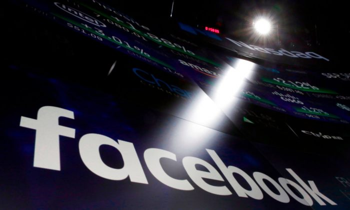 The logo for Facebook appears on screens at the Nasdaq MarketSite in New York's Times Square on March 29, 2018.  (AP Photo/Richard Drew, File)