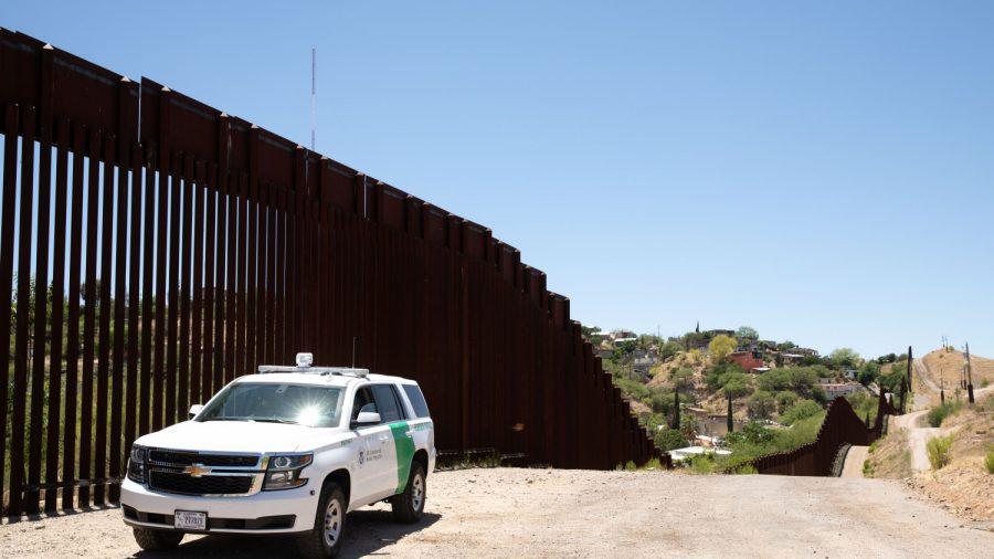 border patrol at fence