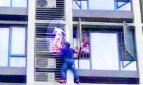 Incredible dad saves daredevil son from side of high-rise