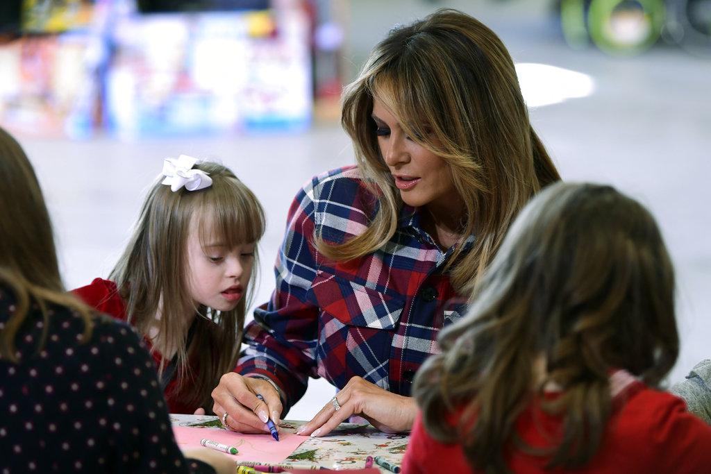 Melania Trump with little girl