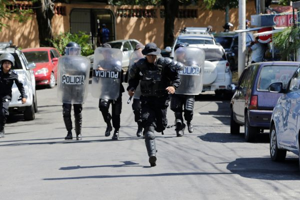 riot police run to dislodge journalists