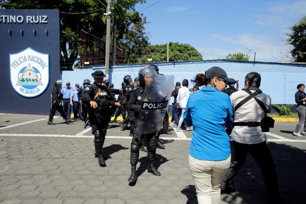 riot police move against journalists