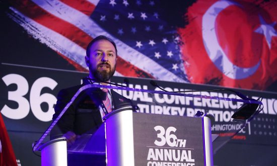 Turkish businessman Ekim Alptekin, chairman of the Turkey-U.S. Business Council, delivers opening remarks during the 36th Annual Conference on U.S. Turkey Relations at the Trump International Hotel in Washington, on May 22, 2017. (Mark Wilson/Getty Images)