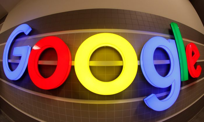 An illuminated Google logo is seen inside an office building in Zurich, Switzerland December 5, 2018. Picture taken with a fisheye lens. (Arnd Wiegmann/Reuters)
