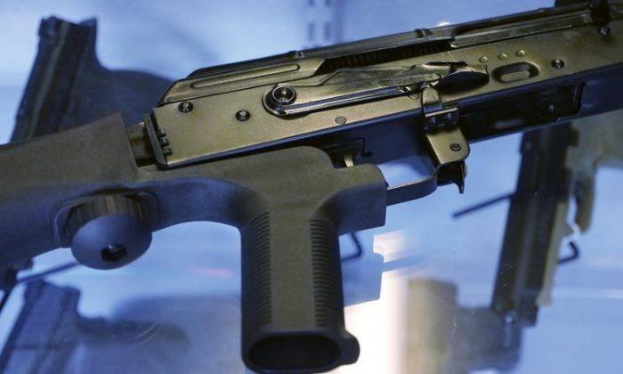 """A little-known device called a """"bump stock"""" is attached to a semi-automatic rifle at the Gun Vault store and shooting range in South Jordan, Utah on Oct. 4, 2017. (Rick Bowmer/AP Photo)"""
