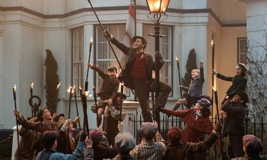"""Mary Poppins Returns"" transports audiences back to 1930s London. Lin-Manuel Miranda (center) as a lamplighter.  (Walt Disney Productions)"