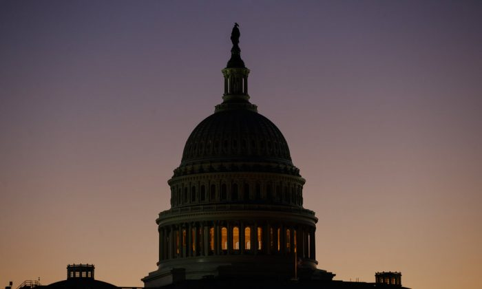 The U.S. Capitol Building Dome is seen before the sun rises in Washington, Dec. 18, 2018. (AP Photo/Carolyn Kaster)
