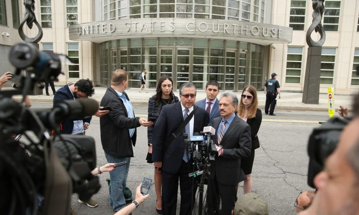 Legal Council representing Keith Raniere and the group NXIVM Mark Agnifilo and Paul DerOhannesian speak to the media outside the U.S. Eastern District Court in relation to sex trafficking charges in Brooklyn, New York City, on May 4, 2018. (Jemal Countess/Getty Images)