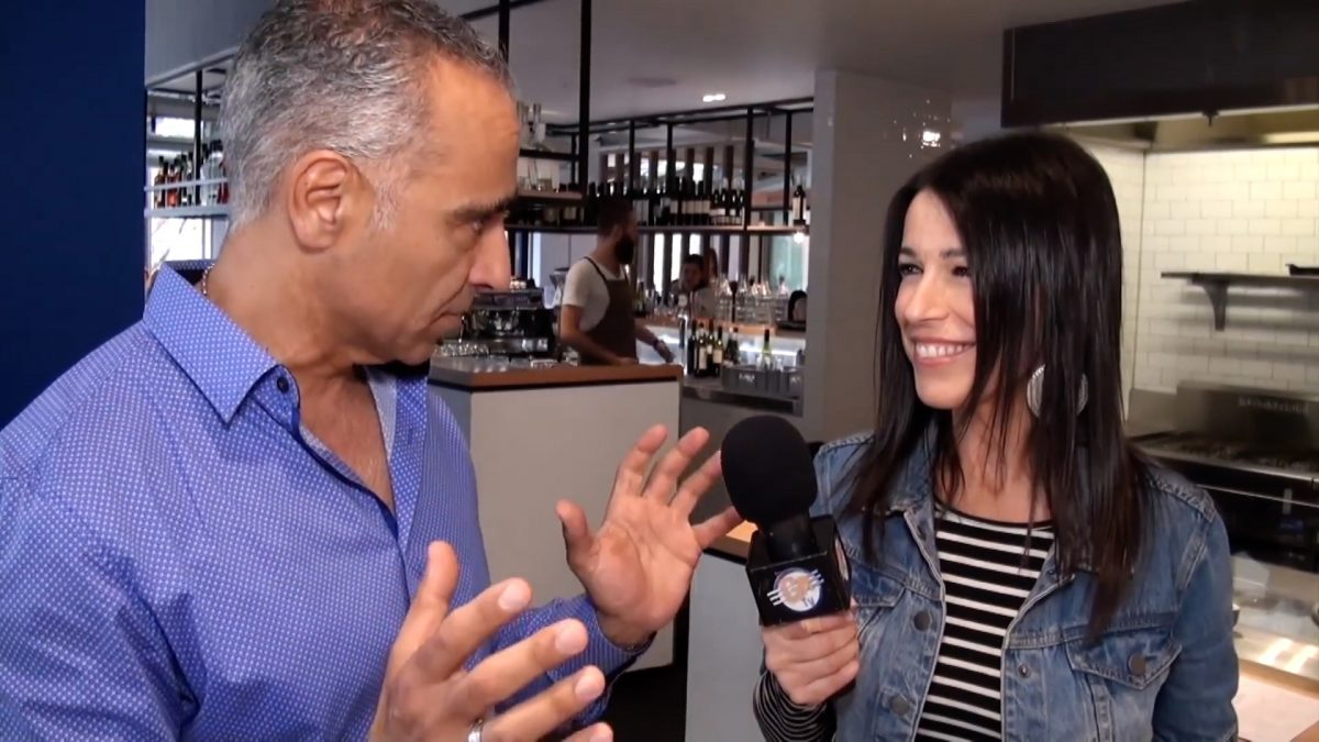 Tina Sofos interviews a shop owner for her food channel on GRTV Australia. (GRTV Australia/Youtube)