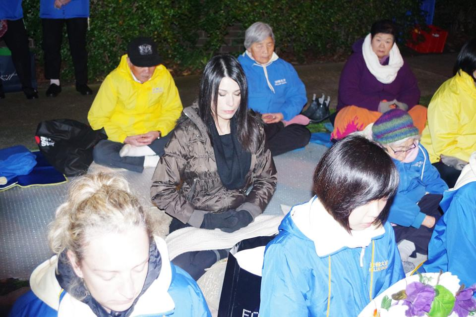 Tina Sofos (middle) practicing the fifth exercise of Falun Dafa with practitioners. (Courtesy of Tina Sofos)