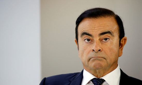 Carlos Ghosn, chairman and CEO of the Renault-Nissan-Mitsubishi Alliance, on the second press day of the Paris auto show, in Paris on Oct. 3, 2018. (Regis Duvignau/Reuters)