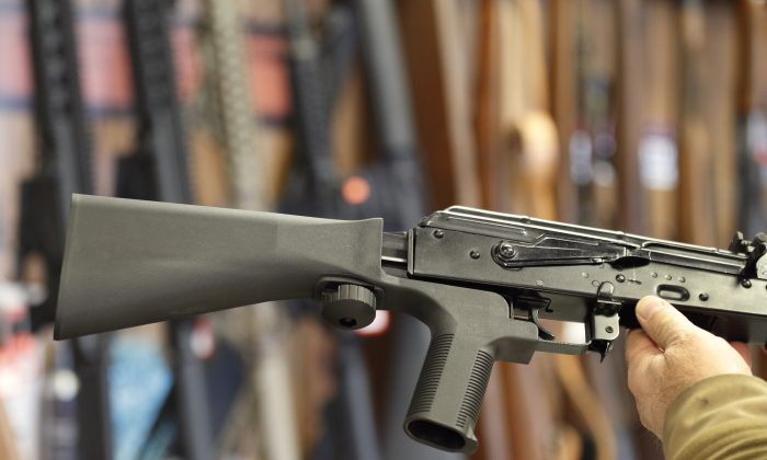 A bump stock device, (left) that fits on a semi-automatic rifle to increase the firing speed, making it similar to a fully automatic rifle, is installed on a AK-47 semi-automatic rifle, (right) at a gun store on Oct. 5, 2017, in Salt Lake City, Utah. The Trump administration has just announced a reversal to a rule that allowed the sale of bump stocks. (George Frey/Getty Images)