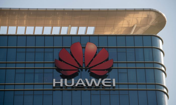 The Huawei logo is seen on a Huawei office building in Dongguan, Guangdong Province, China on Dec. 18, 2018. (Nicolas Asfouri/ AFP/Getty Images)