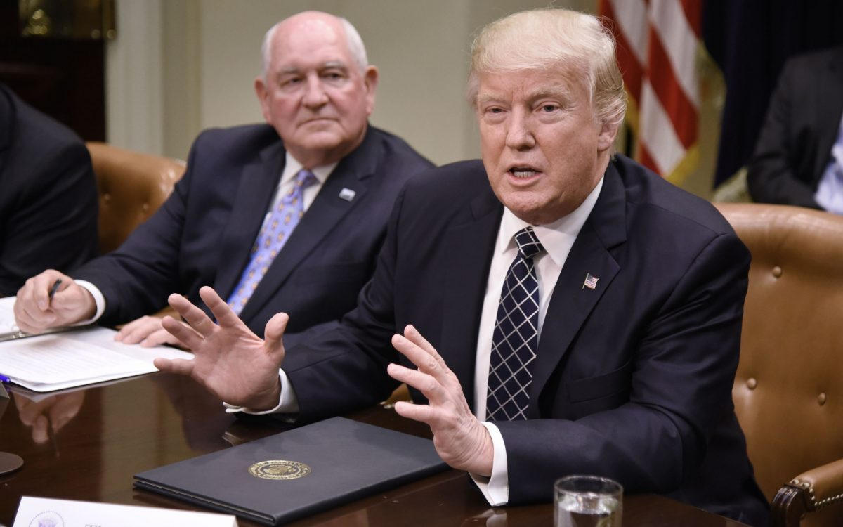 President Donald (R) and Agriculture Secretary Sonny Perdue in the Roosevelt Room of the White House