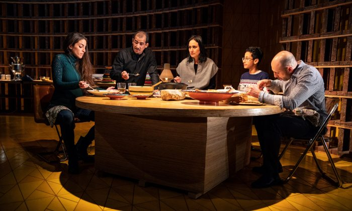 "(L–R) Maryam (Dahlia Azama) visits with the Iraqi-American family, who include Tareq (Nabil Elouahabi), his wife Noura (Heather Raffo), and their son Yazen (Liam Campora), as well as the family's friend Rafa'a (Matthew David), in ""Noura."" (Joan Marcus)"