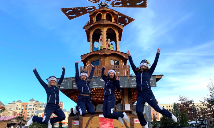 The Indiana Pacemates, the dance team of the Indiana Pacers, jump for joy at the Christmas market in Carmel, Indiana. (Ron Stern)
