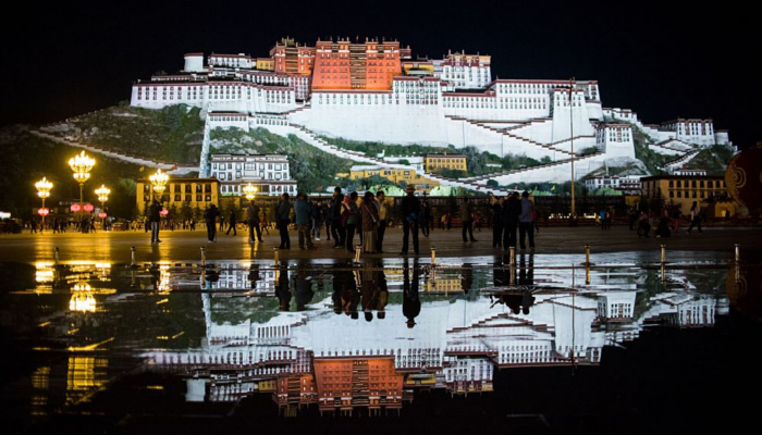 Tourists in front of the iconic Potala Palace in the regional capital Lhasa, in China's Tibet Autonomous Region on Sept. 9, 2016. (Johannes Eisele/AFP/Getty Images)