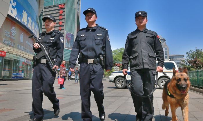 Armed police officers patrol a street in Beijing, China, on May 12, 2014.  (VCG/VCG via Getty Images)