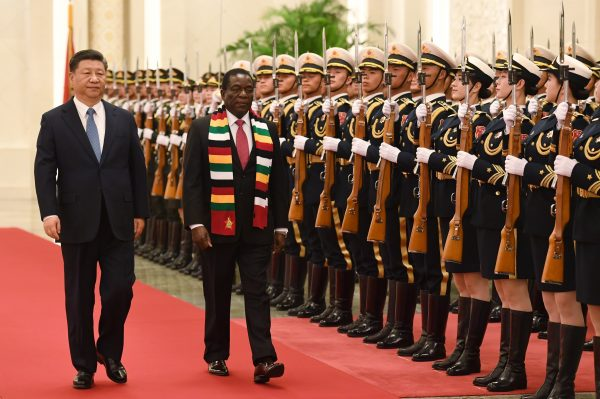 Zimbabwe's President Emmerson Mnangagwa reviews a military honor guard with Chinese leader Xi Jinping during a welcoming ceremony at the Great Hall of the People in Beijing on April 3, 2018. (Greg Baker/AFP/Getty Images)