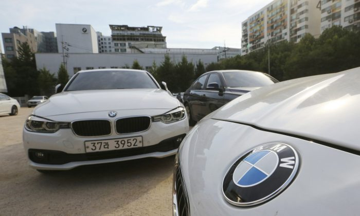 BMW cars are parked for an emergency safety check at the playground of an elementary school near a BMW service center in Seoul, South Korea, on Dec. 24, 2018. (Ahn Young-Joon/AP)