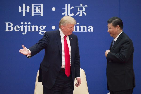 US President Donald Trump (L) gestures next to China's President Xi Jinping