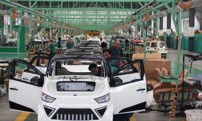 Workers assemble electric cars at a factory in Zouping City, Shandong Province in eastern China, on September 16, 2014. (AFP/AFP/Getty Images)