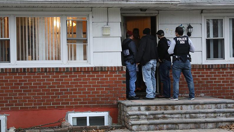 Agents raid an MS-13 house