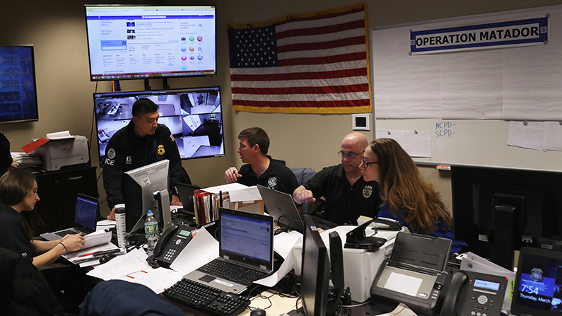 CE agents coordinate anti-MS-13 gang investigations in the Operation Matador control center