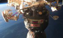 Russian Cosmonauts Take Spacewalk to Probe Mystery of Craft Hole