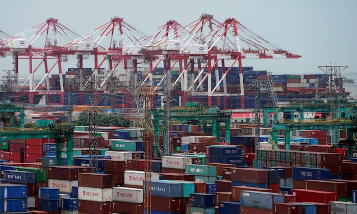 Shipping containers are seen at a port in Shanghai on July 10, 2018. (Aly Song/Reuters)