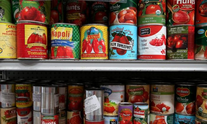 Canned tomatoes line the shelves of a pantry at the SF-Marin Food Bank in San Francisco, Calif. on May 1, 2014. (Justin Sullivan/Getty Images)