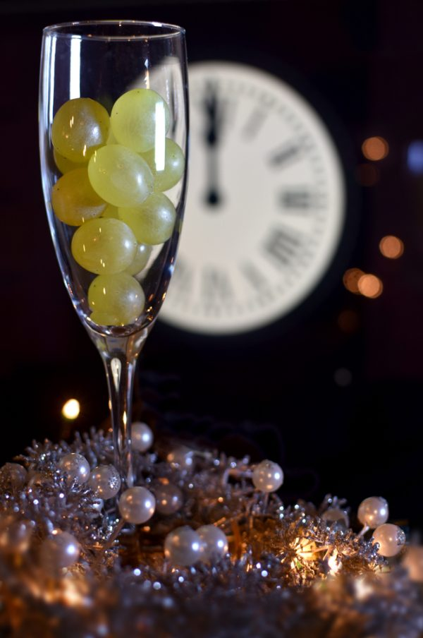 grapes in a champagne glass at midnight on new years