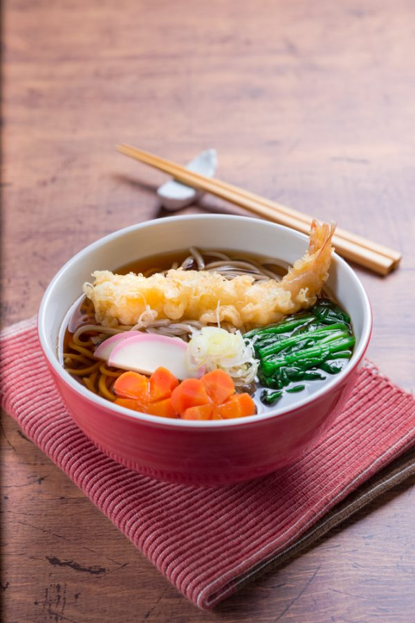 soba noodles in hot broth with shrimp tempura and toppings