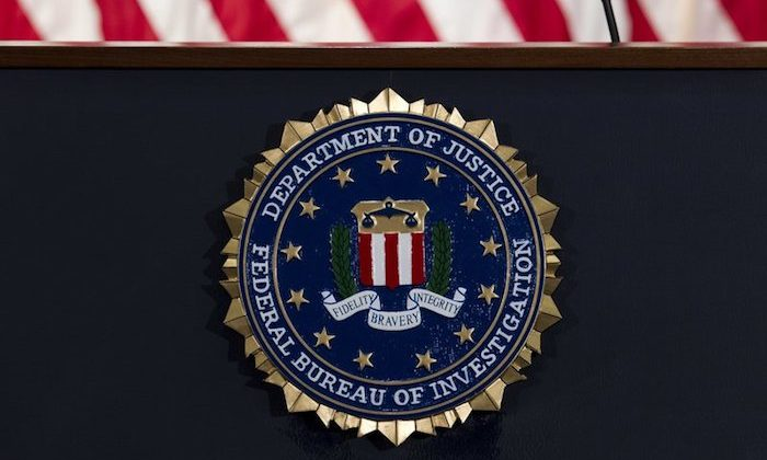 The FBI seal is seen before a news conference at FBI headquarters in Washington. On June 14, 2018. (AP Photo/Jose Luis Magana)