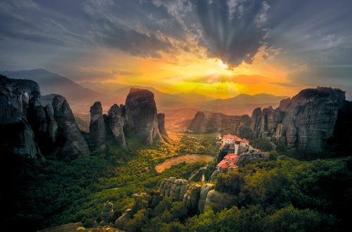 Breathtaking view of Meteora Roussanou Monastery at sunset, Greece. Geological formations of big rocks with Monasteries at the top of them. (Shutterstock)