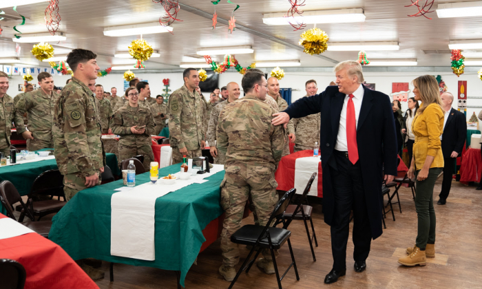 President Donald J. Trump, joined by First Lady Melania Trump, visits U.S. troops at their dining hall Wednesday, December 26, 2018, at the Al-Asad Airbase in Iraq. (Official White House Photo by Shealah Craighead)