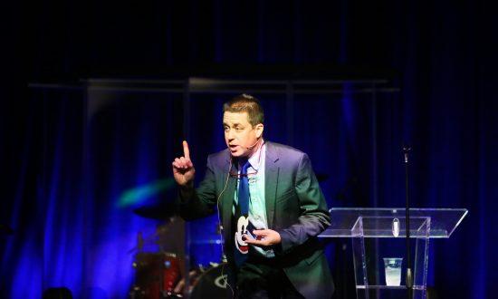 Dr. John DeGarmo giving a speech. (Courtesy of Dr. John DeGarmo)