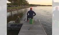 Teen passerby sees dad and son fishing at a lake. Moments later she saw dad jumping into water