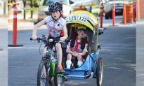 8-year-old boy displays amazing brotherly love by finishing triathlon with disabled sibling