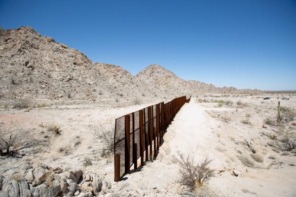 The U.S.–Mexico border where the fence ends at the side of a rocky mountain in the desert near Yuma, Ariz., on May 25, 2018. The U.S. is on the right side of the fence. (Samira Bouaou/The Epoch Times)